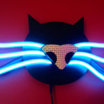 electric kitty on red